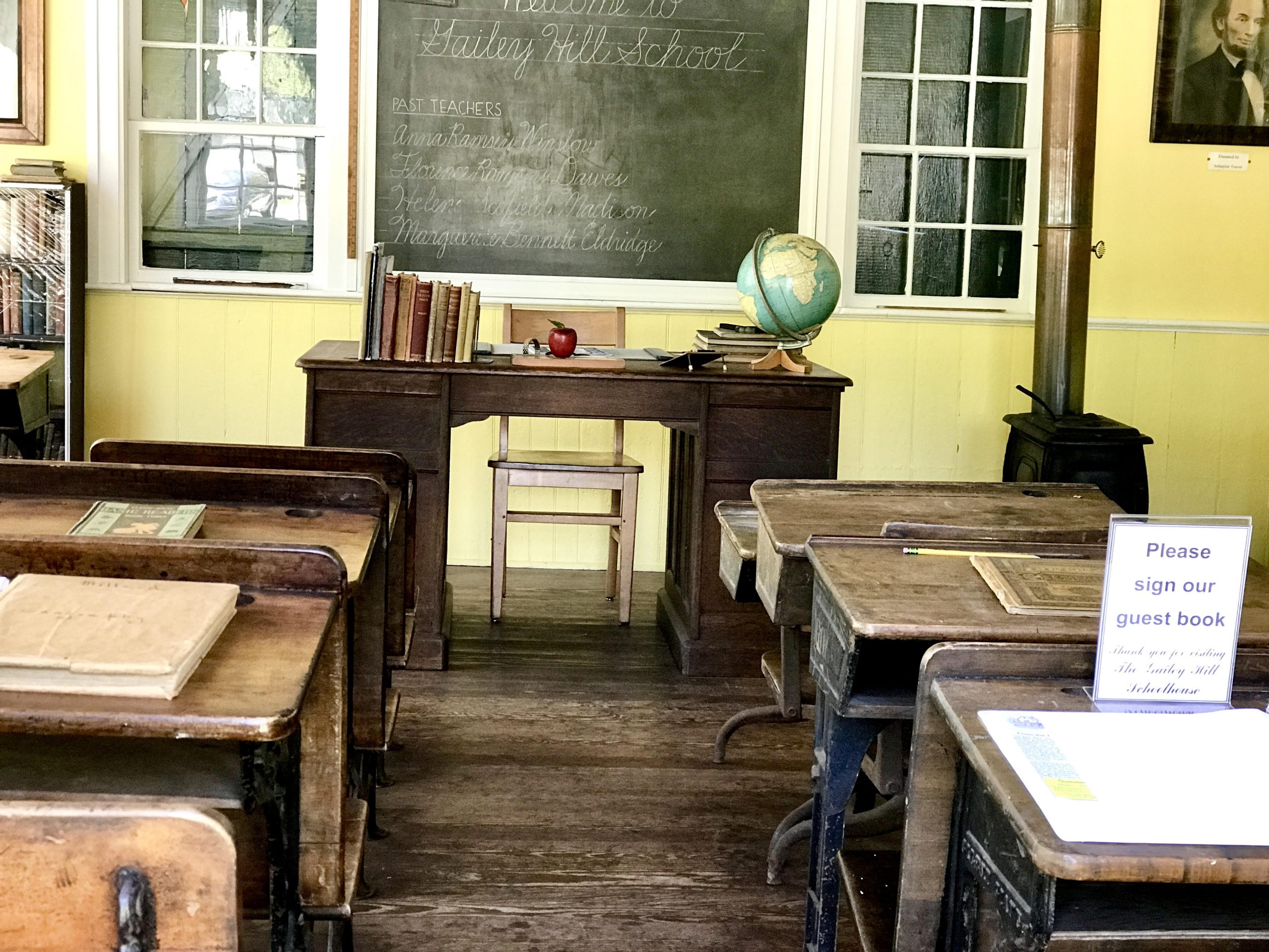 One room school house in lake luzerne ny with desks and blackboard